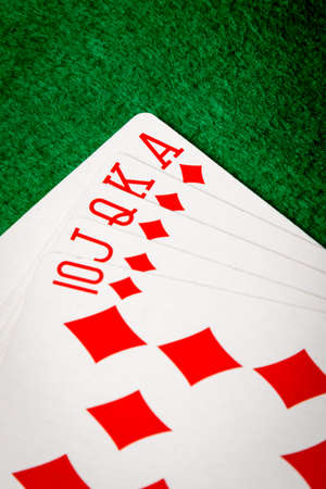 diamonds straight flush poker cards on green table