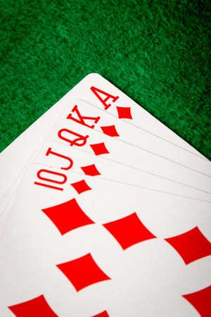 diamonds straight flush poker cards on green table