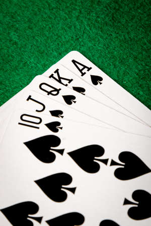 straight flush: spades straight flush poker cards on green table Stock Photo