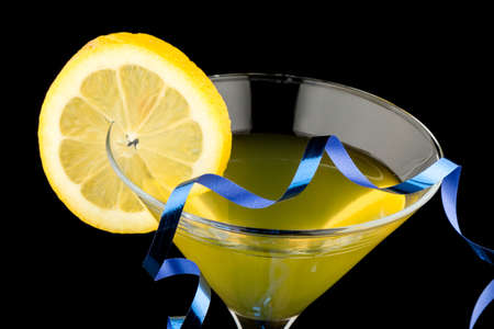 lemon martini on black with blue  party streamer photo