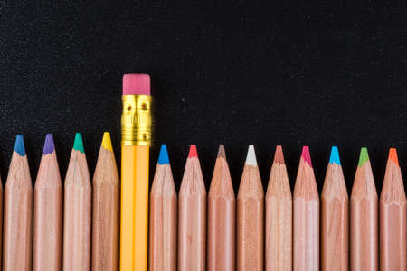 pencil representing the concept of Standing out from the crowd photo