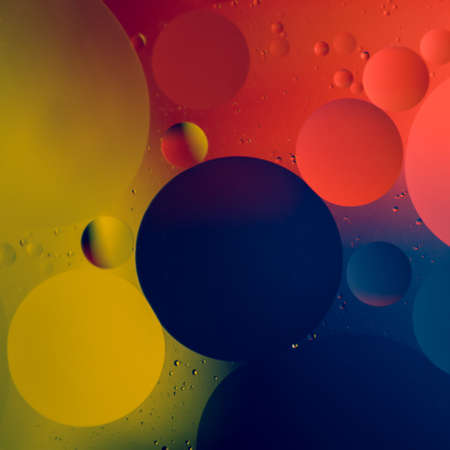 Abstract color round oil drops on water surface photo