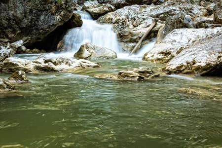 raging: Raging clean fresh mountain river flowing between rocks