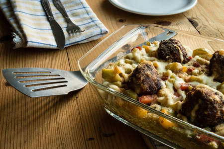 home cooked: home cooked pasta and meatballs with vegetables on wooden table