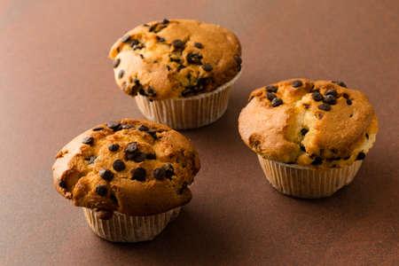 choc: fresh sweet chocolate chip muffins on table Stock Photo
