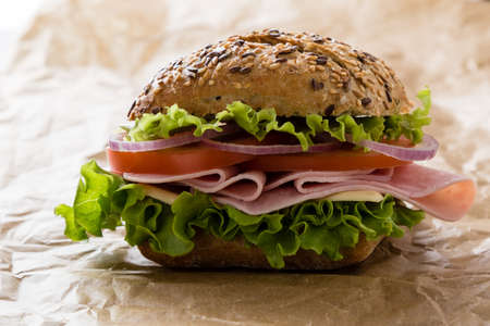 packing paper: brown bun ham sandwich on  packing paper