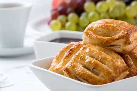 breakfast bowl: sweet puff pastry snack on breakfast table