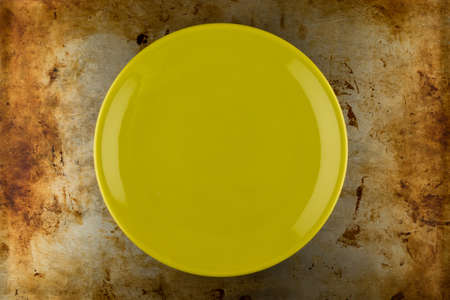 grunge flatware: empty green shiny plate on grungy metal background