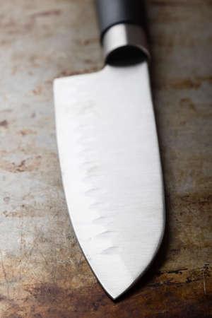 sharp: big metallic sharp shiny knife on table