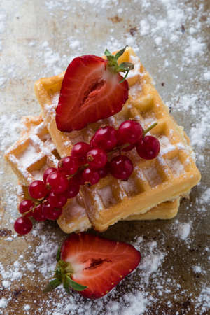 sugary: baked waffle with fruits on sugary steel plate