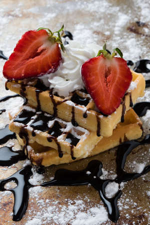 sugary: waffle with chocolate syrup on a sugary steel plate Stock Photo