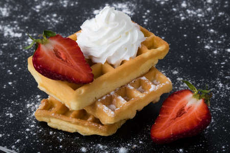 sugary: waffle with strawberry on black sugary table