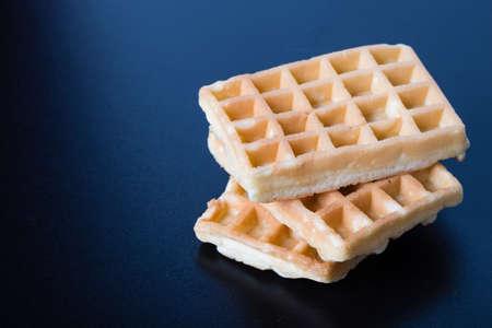 three simple tasty waffles on black table