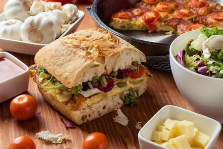 big frittata ciabatta sandwich on breakfast table