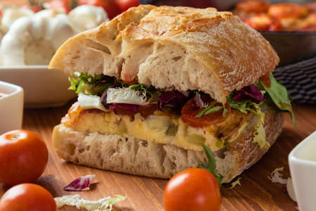 big frittata ciabatta sandwich on breakfast table