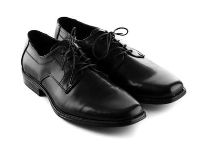 mans: mans black leather shoes on white background Stock Photo