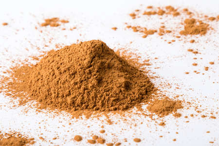 condiment: brown cinnamon condiment powder on white table