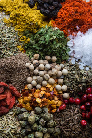 abundance of different color spices on steel plate Stock Photo