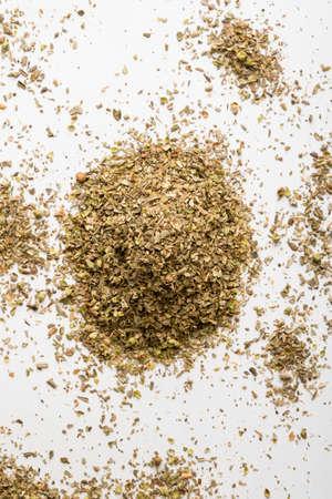 condiment: healthy dried oregano condiment on white table