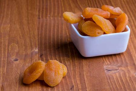 dried orange: sweet dried orange peach on wooden table Stock Photo