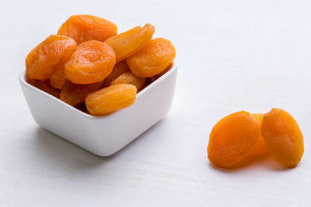 dried orange: sweet dried orange peach on white table Stock Photo