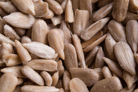 hulled: close up shut of organic hulled sunflower seeds Stock Photo