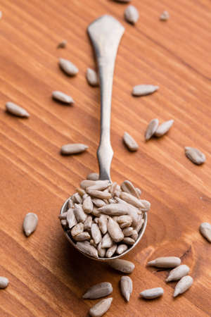 hulled: hulled sunflower seeds on wooden table and spoon
