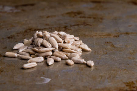 hulled: hulled organic sunflower seeds on steel plate