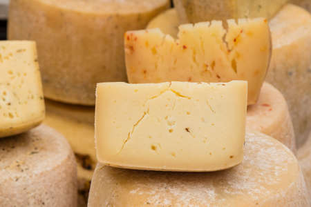 yellow block: block of organic gourmet healthy yellow cheese