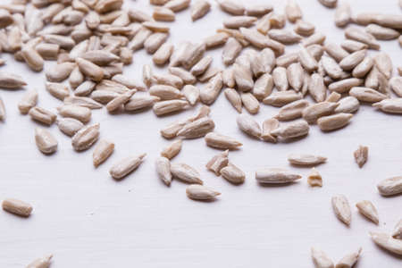hulled: healthy organic hulled sunflower seeds on white table