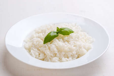 rice plate: cooked rice with basil on white plate