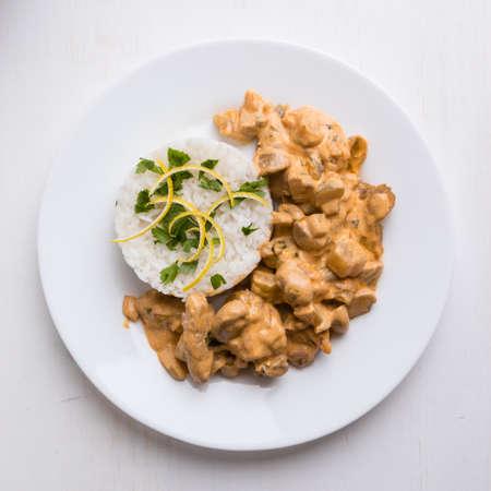 beef stroganoff: beef stroganoff with rice on white plate