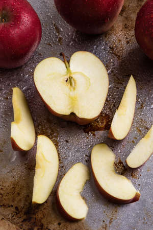 sliced apple: fresh shiny red sliced apple on steel plate