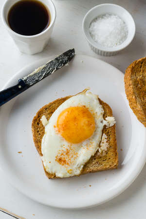 sunnyside: toast with egg sunny side up breakfast on white plate