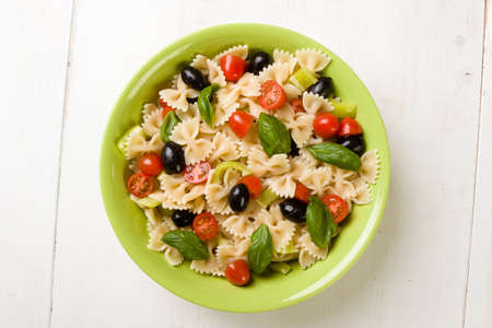 farfalle salad with tomato, basil, olive and pepper Stock Photo