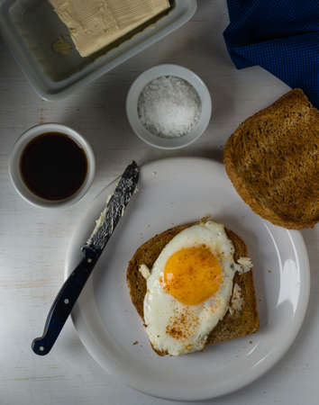 sunnyside: moody image of toast with egg sunny side up breakfast Stock Photo