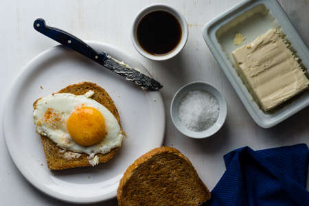 moody image of toast with egg sunny side up breakfast Stock Photo