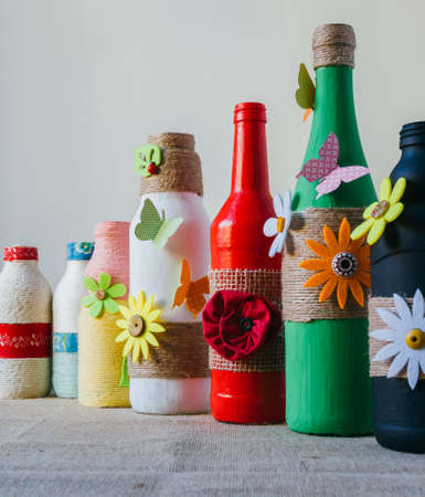 handmade decorated color glass bottles with string