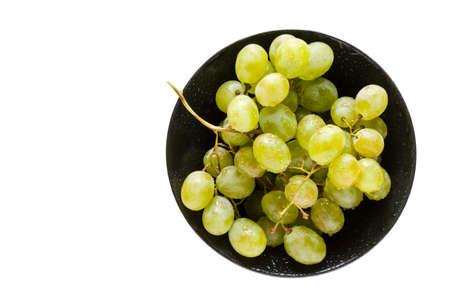 fresh healthy ripe white grapes in black bowl