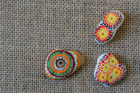 handmade colored, painted beautiful stone on table Stockfoto