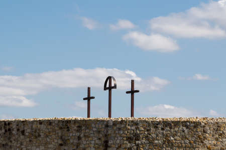 three crosses on hill on blue sky with clouds Stock Photo