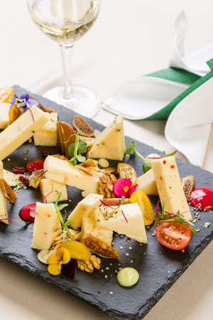 gourmet cheese platter with different types of cheese