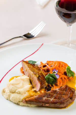 grilled beef with mashed potatoes in white plate