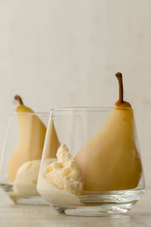 delicious poached pears in glass with ice cream