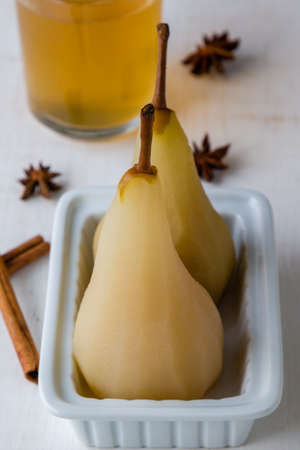 delicious poached golden yellow pears on plate