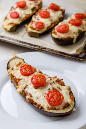 healthy bulgur stuffed eggplant with cherry tomatoes and cheese