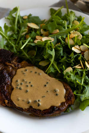 steak with arugula and green peppercorn sauce