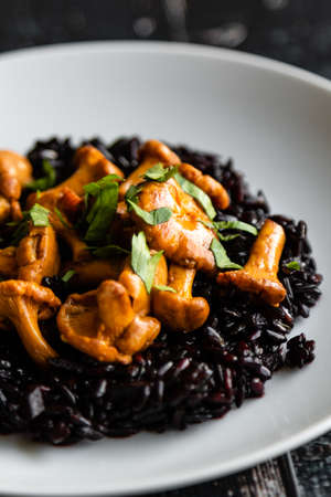 healthy seared girolles mushrooms with black rice