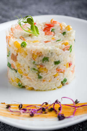 cooked tasty rice portion on white plate Stock Photo