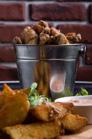 fried chicken wings with potato and dipping sauce Banco de Imagens